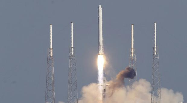 The SpaceX Falcon 9 rocket lifts off from the Cape Canaveral Air Force Station in Florida (AP)