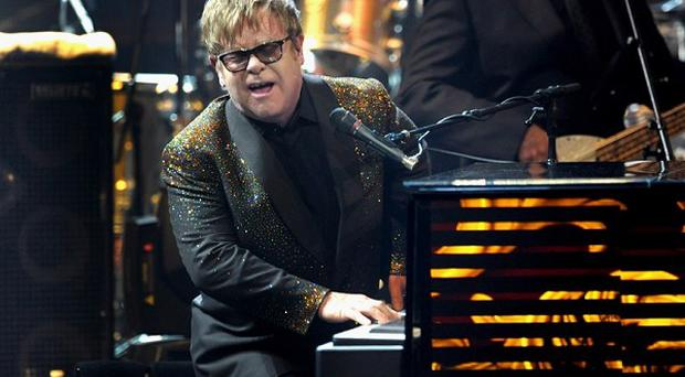 Sir Elton John performs at The Colosseum at Caesars Palace on opening night of his new show, The Million Dollar Piano (AP)