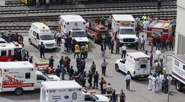 Medical personnel wait for the arrival of passengers involved in a train collision outside of Caracas, Venezuela (AP)
