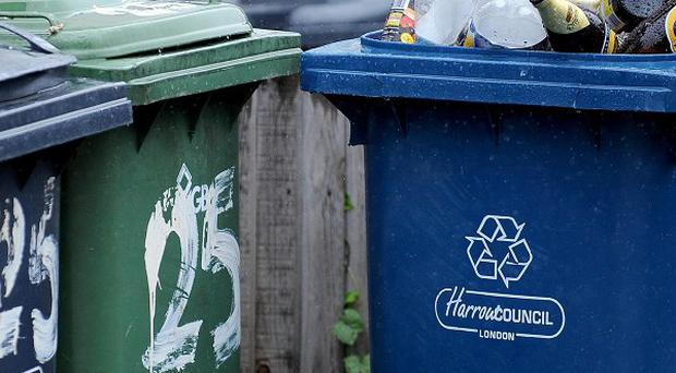 Councils are to be offered financial support to restore weekly rubbish collections
