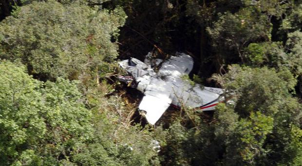 The wreckage of a plane is seen in Bahorok, North Sumatra, as rescuers try to reach the scene (AP)