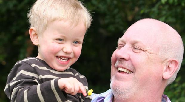 Two-year-old Theo Phillips with his dad Steven