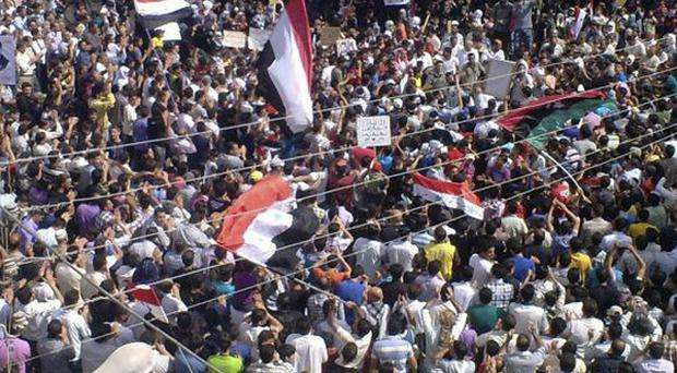 Anti-Syrian president Bashar Assad protesters at a demonstration against the Syrian regime (AP Photo/Shaam News Network)