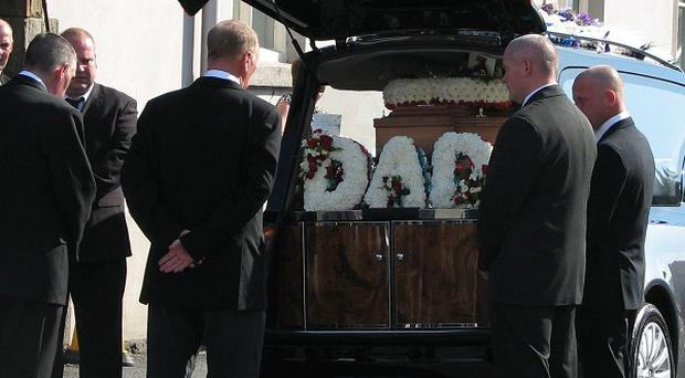 Relatives and friends attend the funeral of miner Garry Jenkins