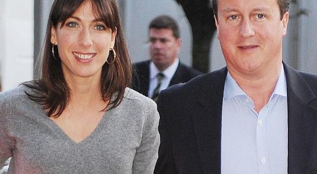 David Cameron and wife Samantha arrive in Manchester for the Tory Party conference, where the PM has vowed to set out an ambitious growth plan