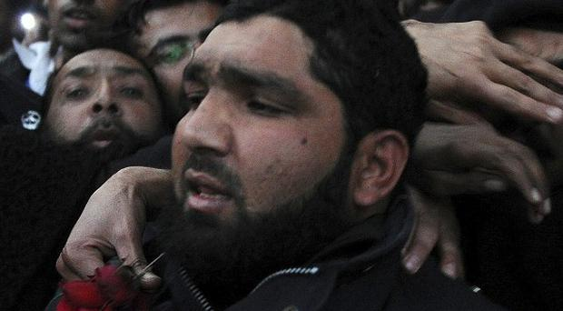 Police officer Mumtaz Qadri has been sentenced to death for the killing of a liberal governor (AP)