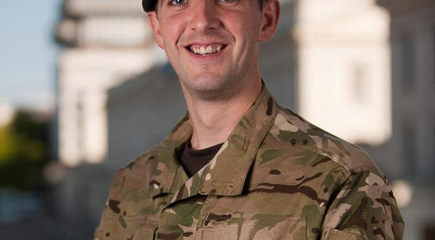 Corporal Jason Robinson of The Queen's Royal Hussars was awarded the Queen's Gallantry Medal