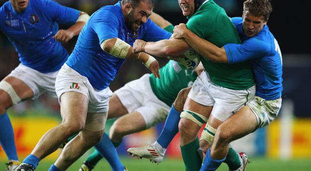 DUNEDIN, NEW ZEALAND - OCTOBER 02: Sean O'Brien of Ireland is tackled during the IRB Rugby World Cup Pool C match between Ireland and Italy at Dunedin Stadium on October 2, 2011 in Dunedin, New Zealand. (Photo by Mark Kolbe/Getty Images)