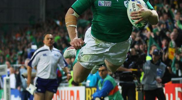 Birthday boy Keith Earls of Ireland dives over to score a try during the IRB Rugby World Cup Pool C match between Ireland and Italy