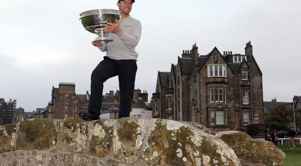 ST ANDREWS, SCOTLAND - OCTOBER 02: Michael Hoey of Northern Ireland lifts the trophy aloft on the Swilken Bridge on the 18th hole after victory in The Alfred Dunhill Links Championship at The Old Course on October 2, 2011 in St Andrews, Scotland. (Photo by Ross Kinnaird/Getty Images)