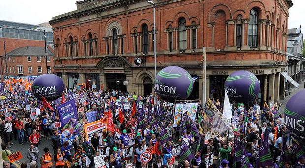 Demonstrators take part in a march through Manchester as the Conservative Party conference opens in the city