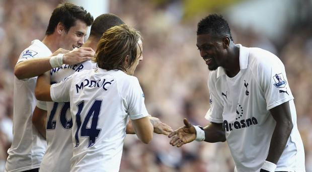 LONDON, ENGLAND - OCTOBER 02: Kyle Walker of Tottenham Hotspur (second left) celebrates scoring his side's second goal with team mates Gareth Bale (L), Emmanuel Adebayor and Luka Modric during the Barclays Premier League match between Tottenham Hotspur and Arsenal at White Hart Lane on October 2, 2011 in London, England. (Photo by Julian Finney/Getty Images)
