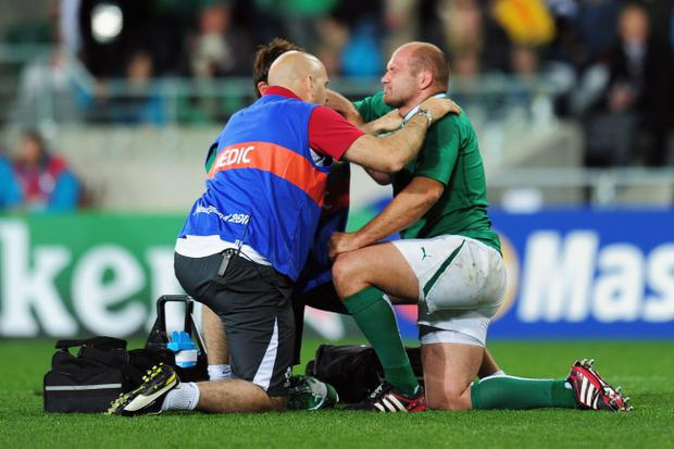 DUNEDIN, NEW ZEALAND - OCTOBER 02: Rory Best of Ireland (R) winces in pain as he receives medical treatment during the IRB Rugby World Cup Pool C match between Ireland and Italy at Dunedin Stadium on October 2, 2011 in Dunedin, New Zealand. (Photo by Shaun Botterill/Getty Images)