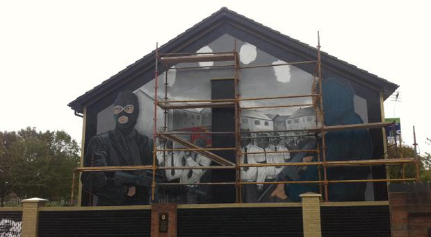 The UVF in East Belfast have started to paint another controversial mural in the area of masked paramilitaries wielding guns.