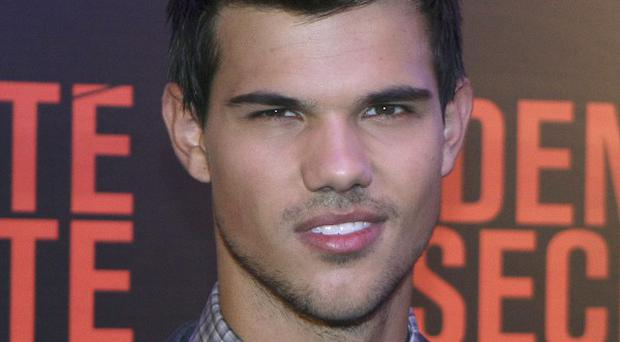Taylor Lautner admits he's beaten by Brits