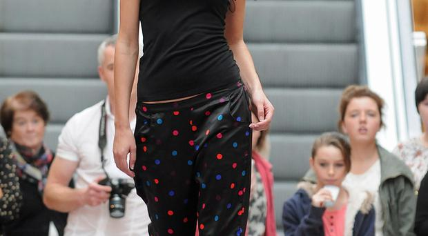 Zara Shaw makes her way down the catwalk in Foyleside Shopping Centre on saturday 1st October during the, Spice Up Your Life, fashion event wearing clothes from La Senza