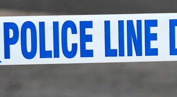 A man was attacked with a meat cleaver and a poker in west Belfast