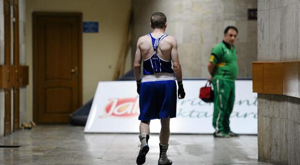 Paddy Barnes walks back to his dressing room yesterday after his shock exit from the World Championships in Azerbaijan