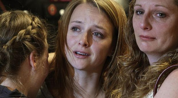 Amanda Knox's sister Deanna Knox, centre, cries after hearing the verdict in Perugia (AP)