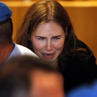 Amanda Knox breaks down in tears after she is acquitted of murdering her British roommate Meredith Kercher (AP)