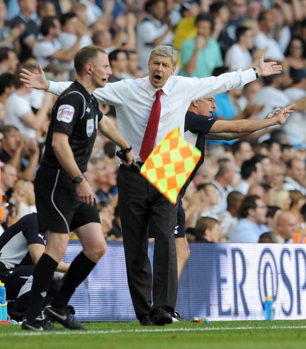 A decision goes against Arsenal manager Arsene Wenger as his team play Tottenham on Sunday