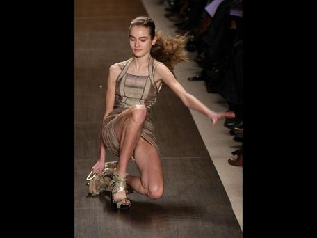 <b>Herve Leger A/W 09</b><br/> Too much heel perhaps. A model takes a tumble during the Herve Leger Autumn Winter New York show.
