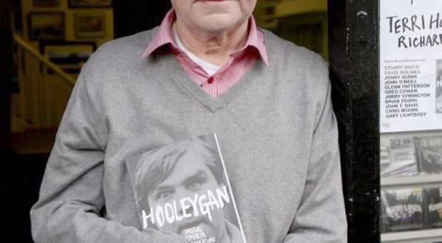 Terri Hooley with his book