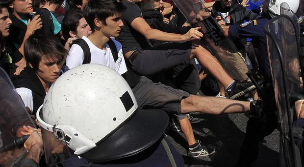 Anti-austerity protesters have blocked the entrances to Greek ministries to voice fears over their job security and pay cuts (AP)