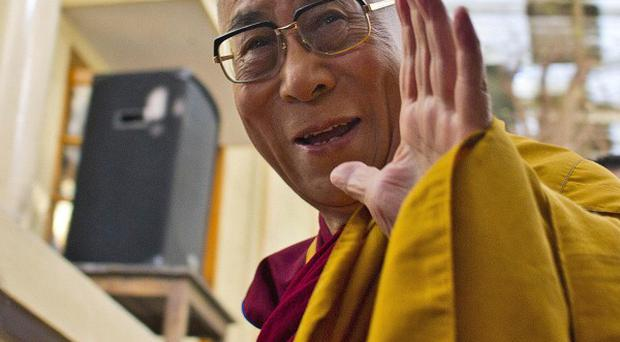 Tibetan spiritual leader the Dalai Lama has cancelled his South Africa visit (AP)