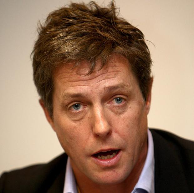 Actor Hugh Grant appealed to Prime Minister David Cameron to 'stand up' to Rupert Murdoch