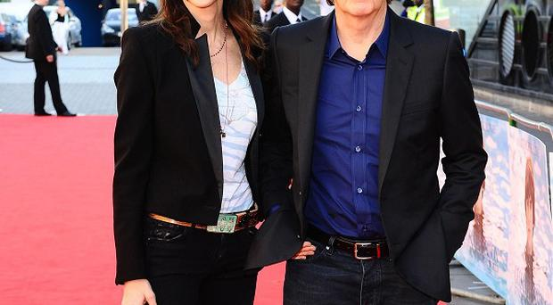 Sir Paul McCartney and Nancy Shevell arrive at the premiere of George Harrison: Living In The Material World