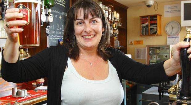 Landlady Karen Murphy celebrates at her pub in Portsmouth