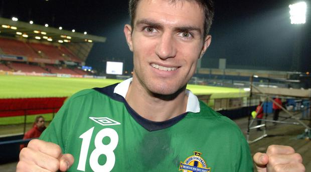 Although ruled out of Friday's clash with Estonia, Aaron Hughes could still be at Windsor Park to wave goodbye to the Northern Ireland fans