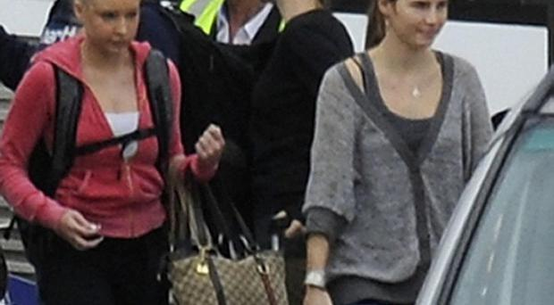 Amanda Knox, right, at Heathrow Airport as she changes planes to head home to the US after her acquittal