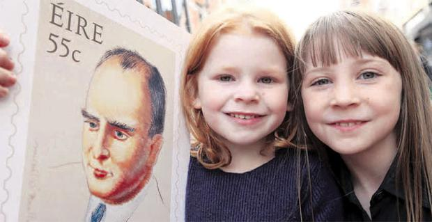 The granddaughters of Tyrone's Brian O'Nolan, Freya (5) and Aoibhe (8) hold a commemorative stamp celebrating the centenary of the birth of the writer and columnist, which has gone on sale. The Strabane-born author, who wrote under a number of pseudonyms, was known and loved for his satirical style
