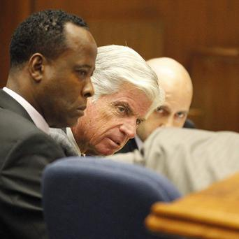 Conrad Murray, left, confers with his lawyers during his trial over the death of Michael Jackson (AP)