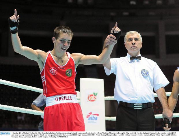 Michael Conlan has his hand raised in triumph yesterday at the World Championships
