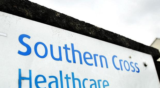 Two members of staff at a Southern Cross care home have been arrested on suspicion of ill-treatment and neglect