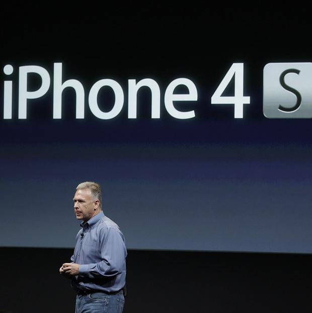 Apple senior vice-president Phil Schiller talks about iPhone 4S during an announcement about the new version of the device (AP)