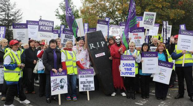 UNISON members in the health and education sectors stage a 24 hours strikein relation to the governments budget cuts. Members of UNISON picturedoutside the Lagan Valley hospital in Lisburn