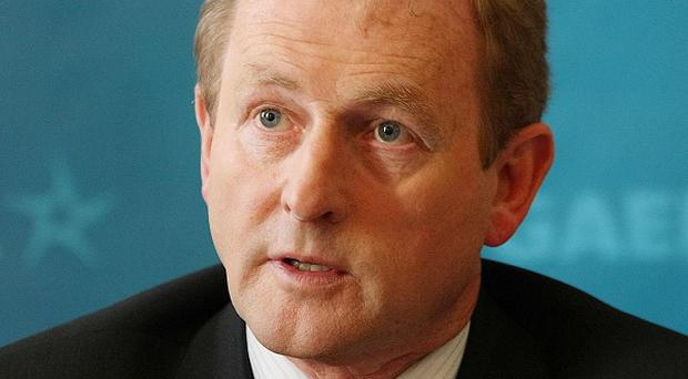 Taoiseach Enda Kenny has denied covering up an investigation into government spending