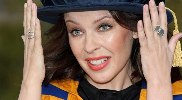 Singer Kylie Minogue dressed for the occasion as she was presented with an honorary degree by Anglia Ruskin University