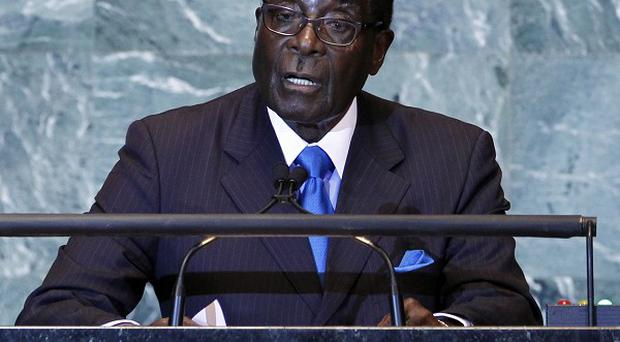 Zimbabwe president Robert Mugabe is accused of ordering mass evictions to break up political opposition(AP)