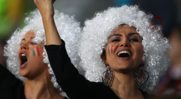 Fans enjoy the atmosphere during the match between Ireland and Italy at Dunedin Stadium on October 2, 2011 in Dunedin