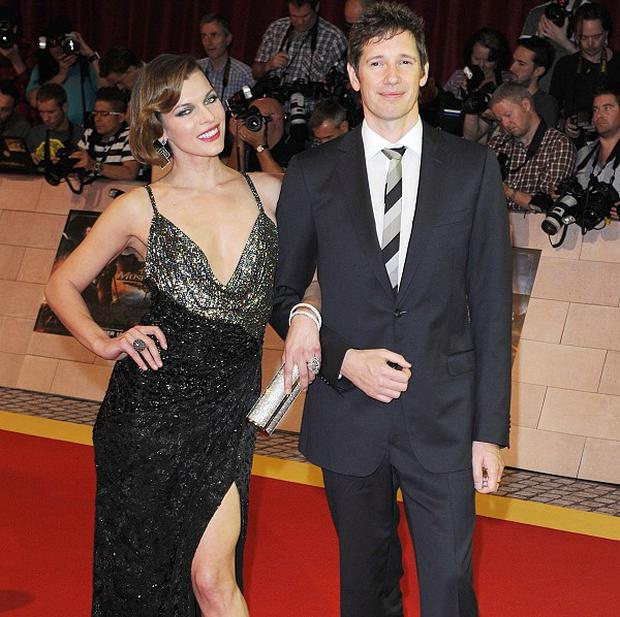 Milla Jovovich and her husband Paul WS Anderson at the world premiere of The Three Musketeers