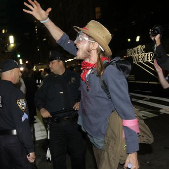 An Occupy Wall Street protester yells at police officers as they make arrests in New York (AP)