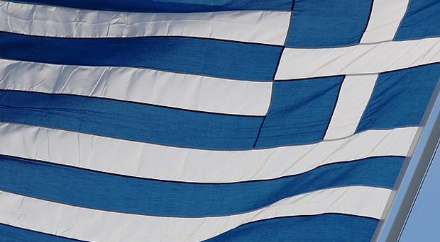 The Greek parliament is to vote on a bill to cut public sector salaries