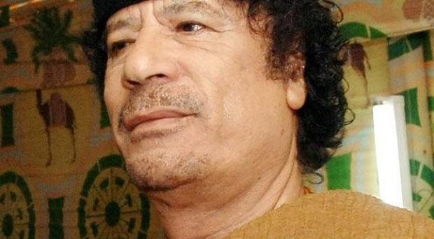 Nato's bombing campaign in Libya is to continue despite the collapse of Muammar Gaddafi's regime