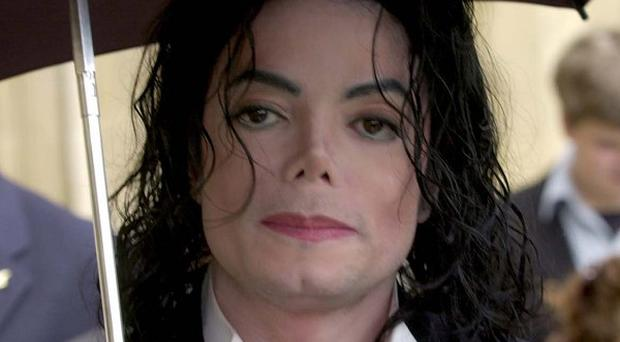 Lawyers for Michael Jackson's doctor claim that the pop star gave himself a fatal dose of the drug propofol
