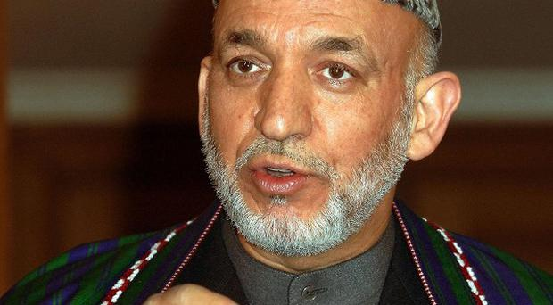 Afghan intelligence officials have broken up a cell plotting to kill President Hamid Karzai